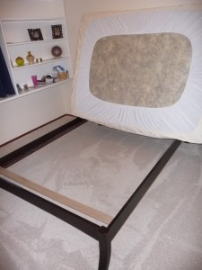 Remove your linens and lean the matress up against the wall while it sits on the frame.